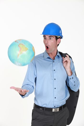 Engineer tossing a globe