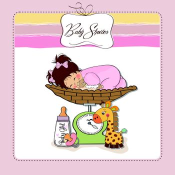 baby girl on on weighing scale