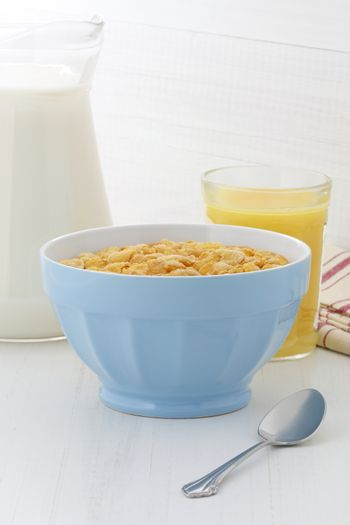 delicious and healthy corn flakes, with fresh milk and orange juice