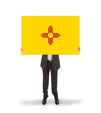 Smiling businessman holding a big card, flag of New Mexico