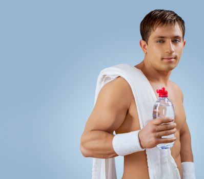 a muscular handsome man with bottle of water