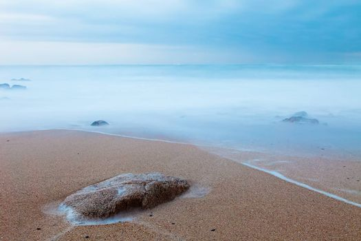 Long exposure at a beach in the north of Portugal. Copy space.
