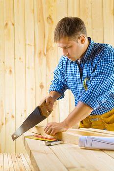 carpenter cuts the plank