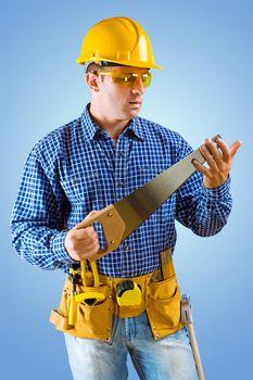 carpenter holding handsaw
