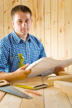 carpenter with blueprint