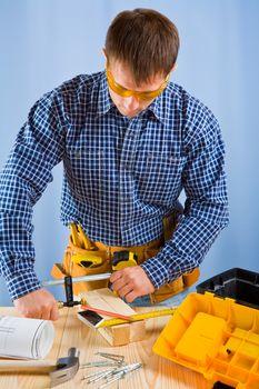 carpenter works with carpenter vise
