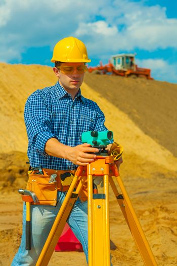 a contractor with theodolite