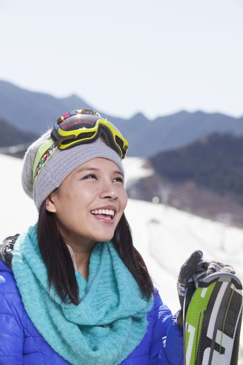 Young Woman Carrying Her Skis