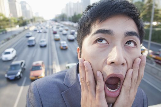 Young Angry Businessman Yelling Over Freeway