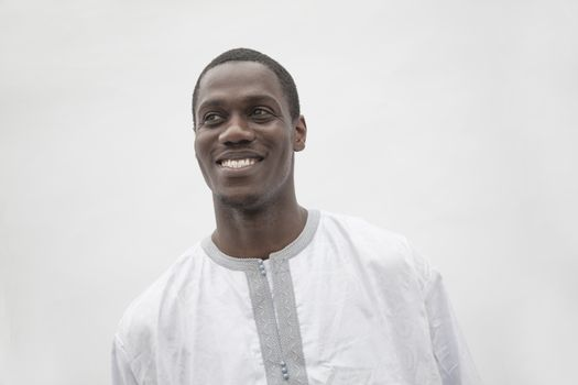 Portrait of young man in traditional African clothing, studio shot