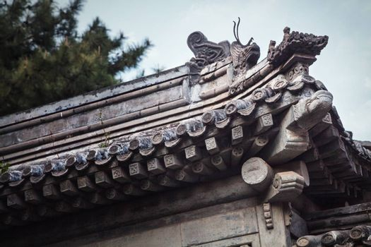 Close-up of ornate roof tiles on Chinese building.