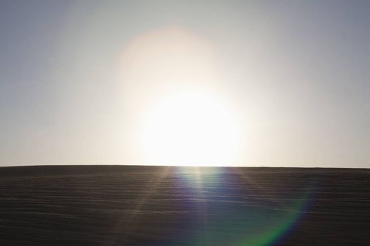 Sun coming down over a sand dune, no people, landscape, lens flare