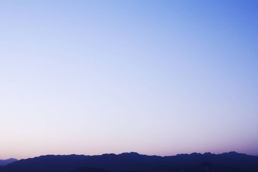 Landscape of mountain range and the sky at dusk, China