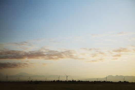 Landscape of a wind farm at sunset
