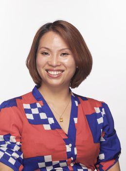 Portrait of smiling woman looking at camera, studio shot