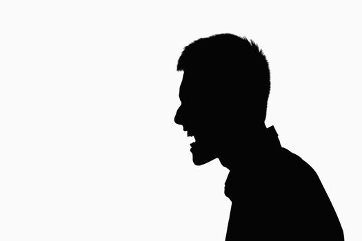 Silhouette of man screaming.