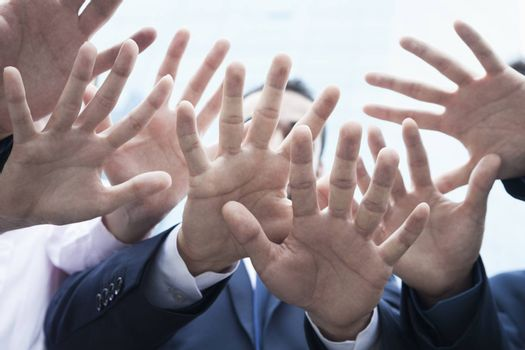 Close-up of four business people's hands