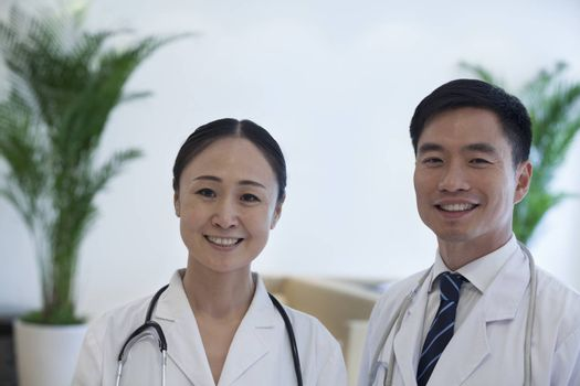 Portrait of two smiling doctors in the hospital
