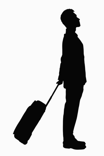 Silhouette of businessman with suitcase.