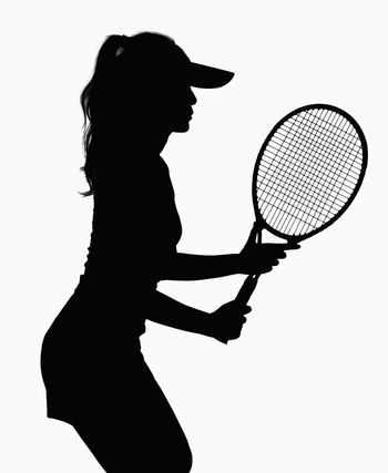 Silhouette of woman with tennis racket.