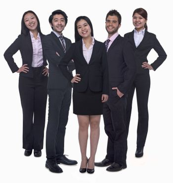 Portrait of five young smiling businesswomen and young businessmen, looking at camera, studio shot