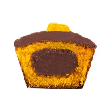 A delicious chocolate and carrot cupcake cut in half isolated on a white background.
