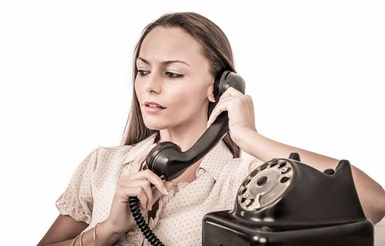 Beautiful business woman talking with a vintage phone