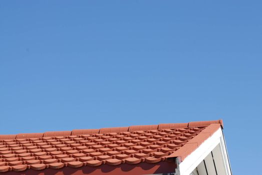 Roof with red tiles and blue sky