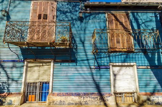 Blue corrugated siding of an old building in La Boca neighborhood of Buenos Aires, Argentina