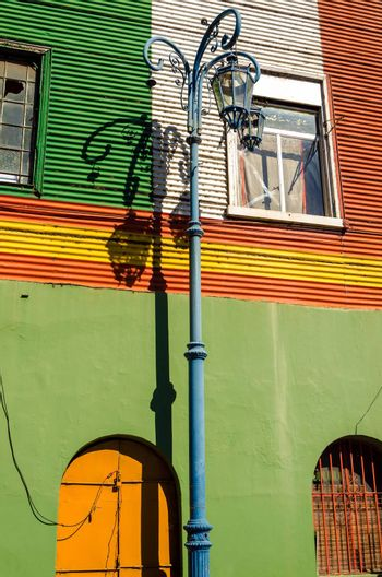 Streetlight set against a colorful wall in La Boca neighborhood of Buenos Aires, Argentina