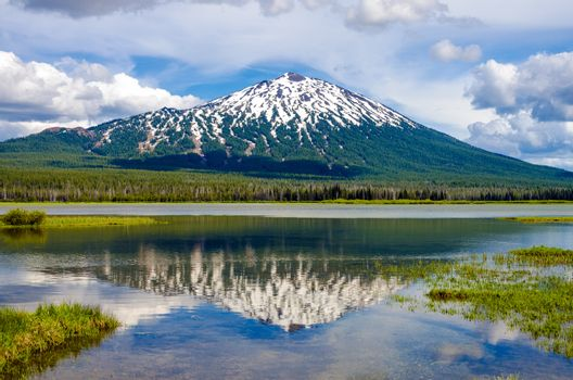 View of Mount Bachelor in Oregon with a reflection in a lake
