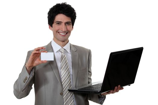 Man with laptop and calling card