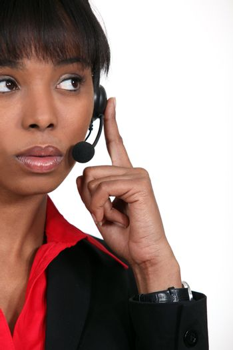 black receptionist with earphones