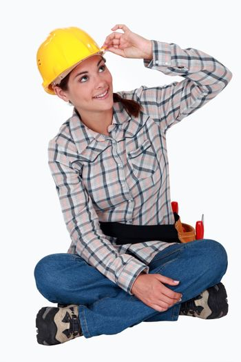 Tradeswoman touching the brim of her hat