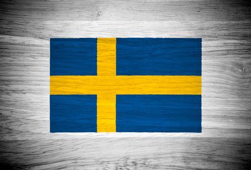 Sweden flag on wood texture