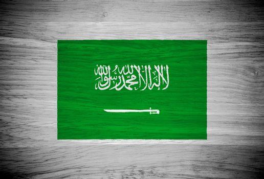 Saudi Arabia flag on wood texture