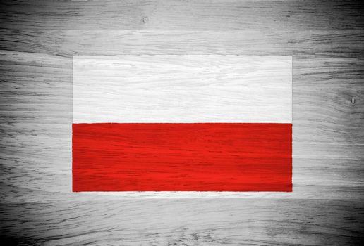Poland flag on wood texture
