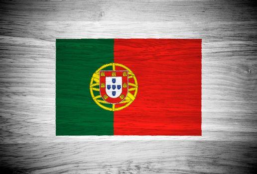 Portugal flag on wood texture