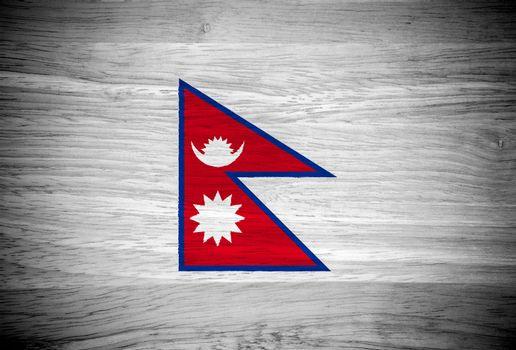 Nepal flag on wood texture