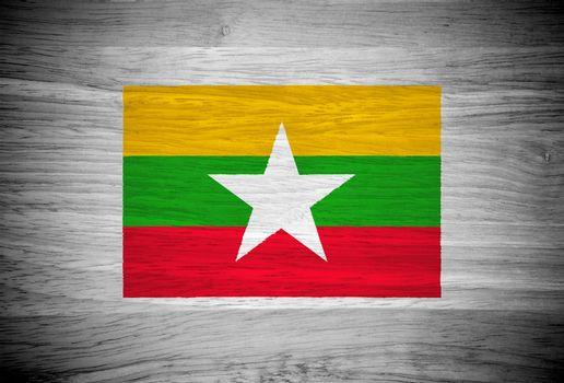 Myanmar flag on wood texture