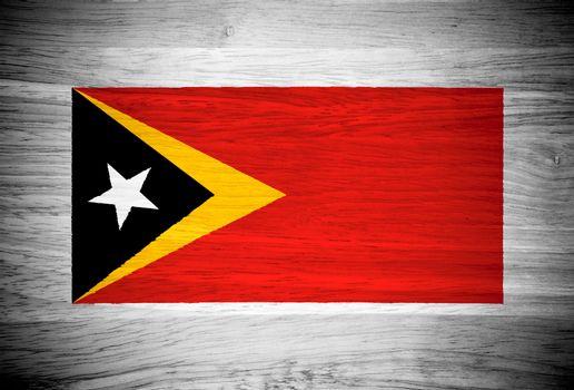 East Timor flag on wood texture