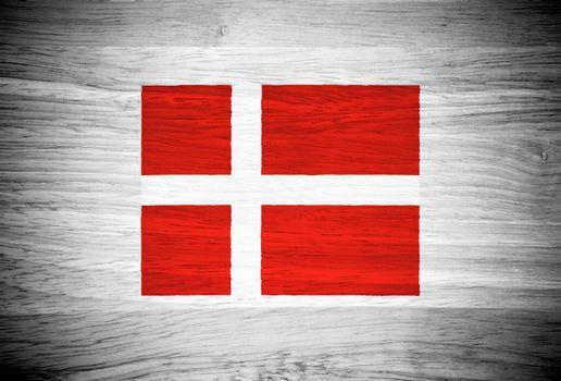 Denmark flag on wood texture
