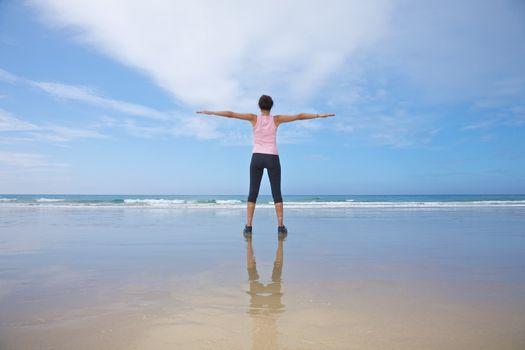 woman exercising on seashore