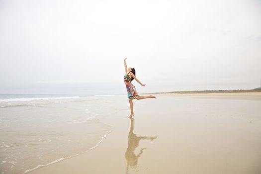 woman touching sky on seashore