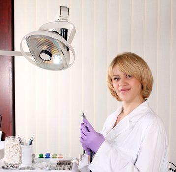 female dentist in dental office