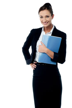 Smiling secretary holding spiral notebook