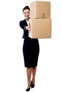 Female executive displaying carton boxes