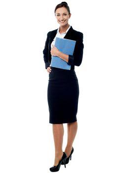 Office secretary posing with notebook