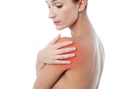 Young woman having shoulder pain