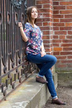 Full-length portrait of a pensive girl.